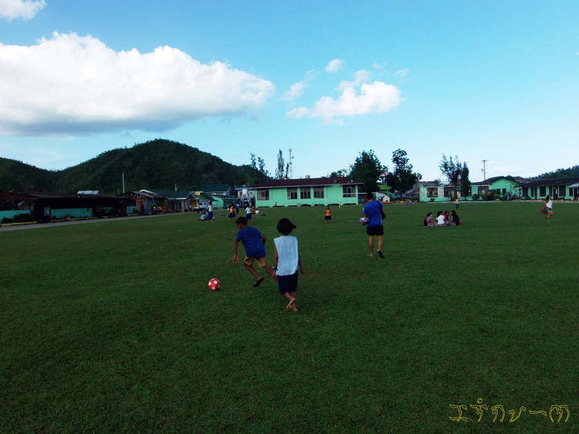 Children playing football.