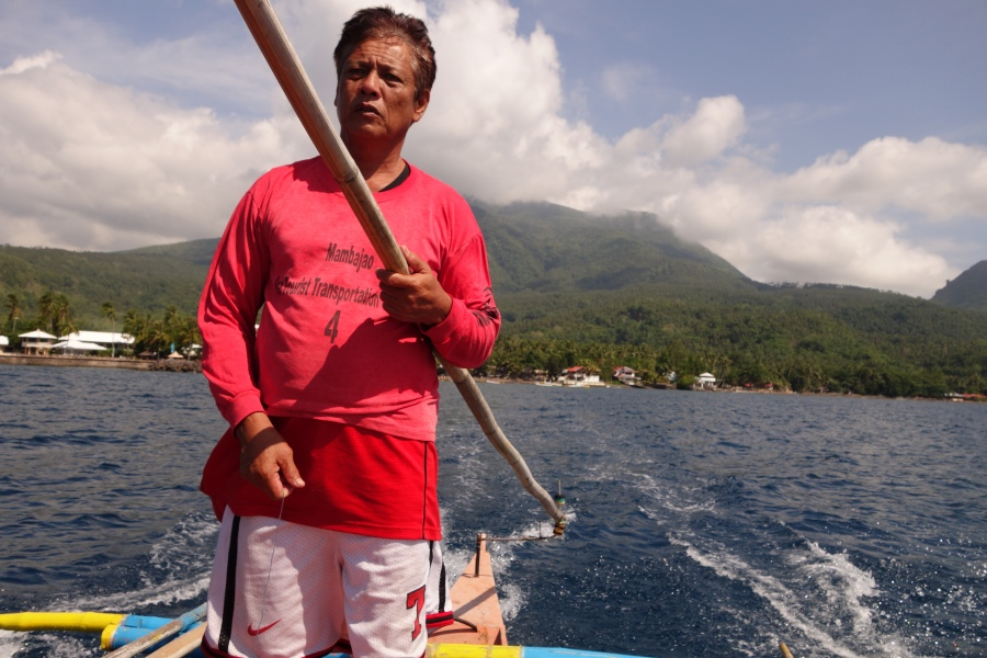 Our quiet boatman who patiently waited for us in the White Island.